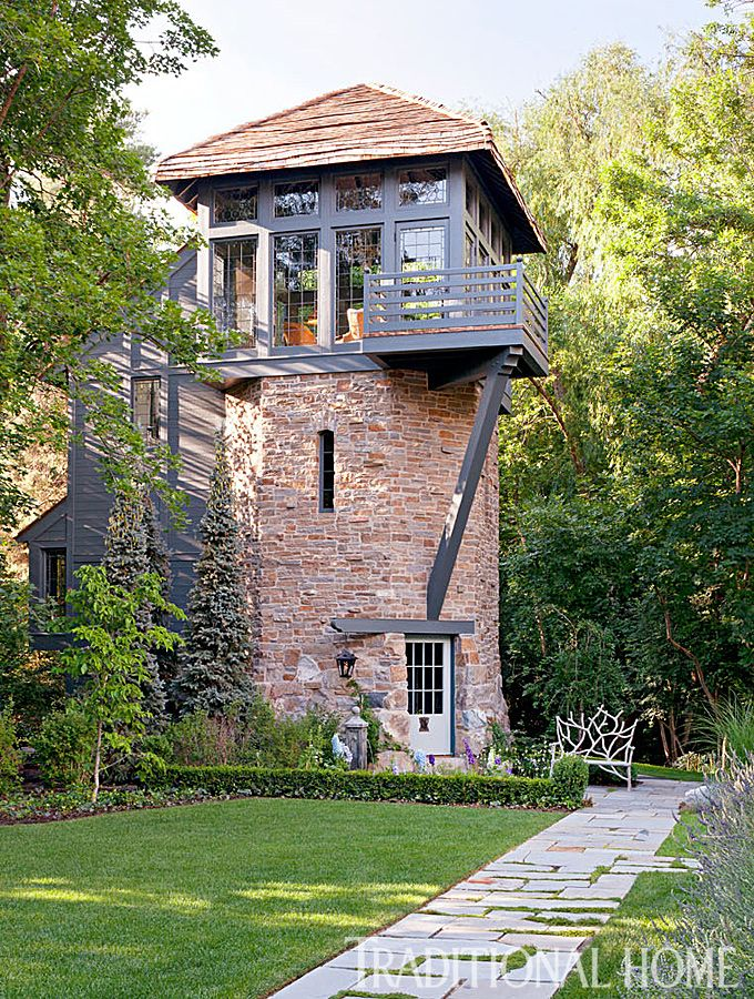 A focal point in the landscape, the Rapunzel tower was built as a playhouse but doubles as guest quarters. - Photo: Emily Minton Redfield