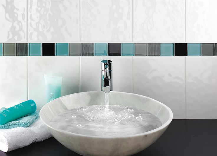 White bathroom tiles look stylish in any bathroom. Shown here: Alpine White