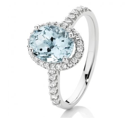 Beautiful aquarmarine to add a little blue to your wardrobe.   This ring features a natural aquarmarine with 0.30ct of diamonds TDW surrounding the coloured stone and down the shoulders. Set in 18ct white gold, this ring makes a statement in timeless style. CW1