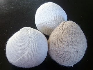 Dryer balls from old socks. Add essential oil to the center or soak in fabric softener and let dry.  These can help move laundry around so it dries faster.