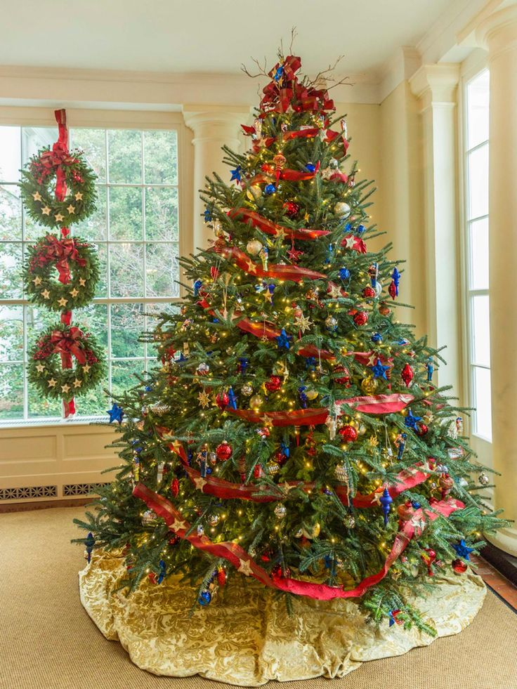 This tree, which sits inside the East Landing of the White House, is a perfect patriotic salute to the holidays. Shimmering red, white and blue ornaments are set off by a red ribbon and soft, white twinkle lights:
