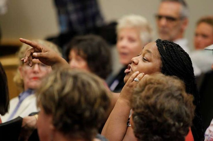 South Carolina Republican's town hall starts rowdy, ends peaceably - February 25, 2017:    Cassandra Buckner of Goose Creek, SC, shouts her views at a town hall meeting for constituents hosted by U.S. Senator Tim Scott in North  Charleston