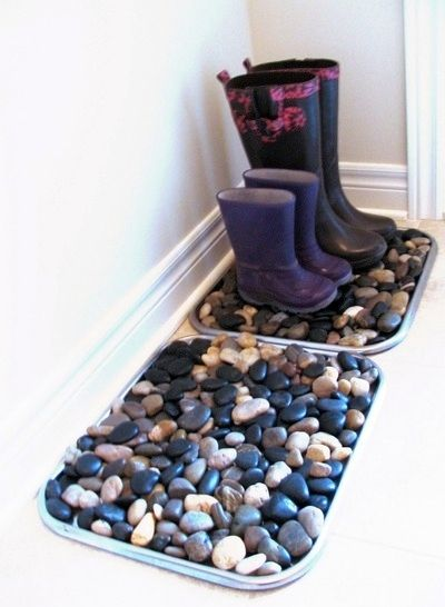 fill shoe trays with stones to disguise all the muck and salt that is sure to come in on shoes and boots over the next few months!
