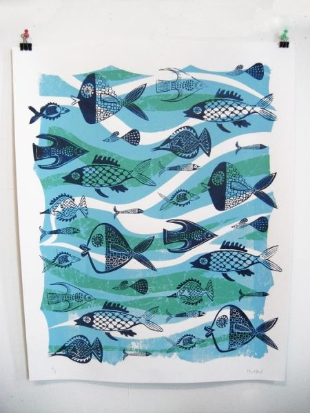 students carve out of small erasers/blocks fish print. middle school art lesson.