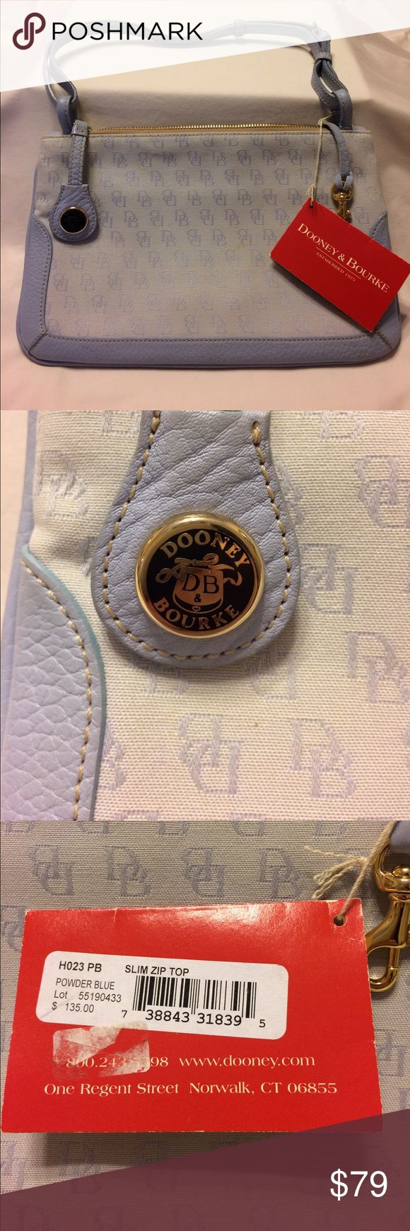 NWT Purse by Dooney & Bourke Pale blue purse with zippered pocket inside plus small pocket. Width is 11 inches and height is 7 1/4 and strap is 20 inches doubled (meaning up to 38 inches). New, never used but has two small spots( see photo). Dooney & Bourke Bags Shoulder Bags