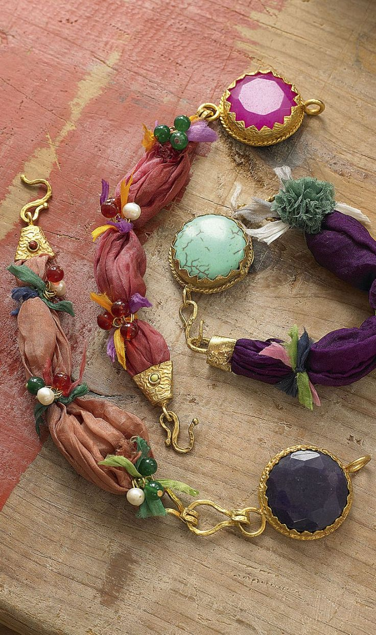 Turkish jewellery made from silk ribbons, large faceted glass beads and gold coloured metal work. By Plümo.