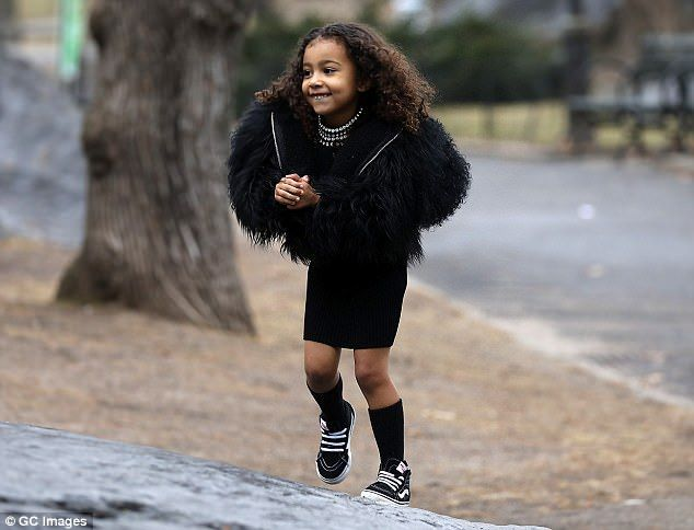 Like a monkey! The daughter of Kim and Kanye West was all smiles as she climbed around on the rocks with her cousin P