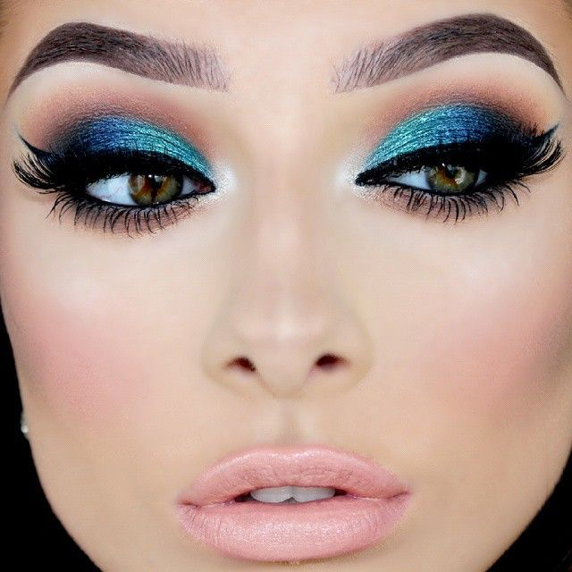 BLUE -- Blue eyeshadow paired with nude lips. Totally wearable in the right circumstance.