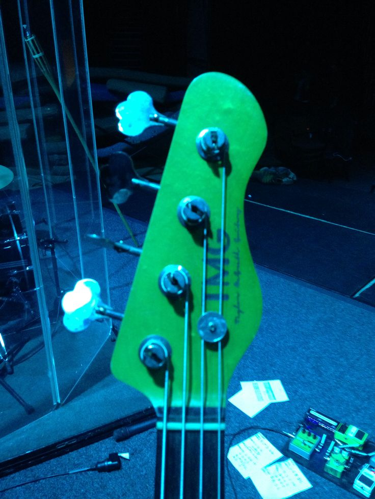 TMG branding and headstock shaping see. Here on a bass model.