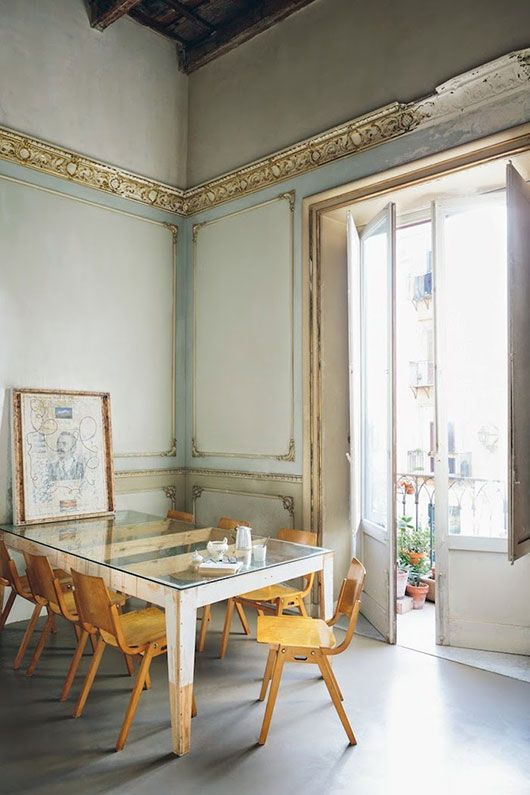 modern dining table & chairs, vintage gilt ceiling & wall details