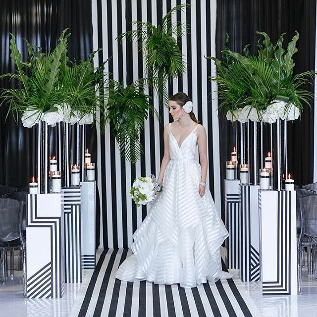 This graphic #ceremony with pops of electrifying green is no optical illusion- it really is as dreamy as it appears! | Photography By: Sweet Pea Photography | WedLuxe Magazine | #WedLuxe #Wedding #luxury #weddinginspiration #luxurywedding #eventdesign #decor