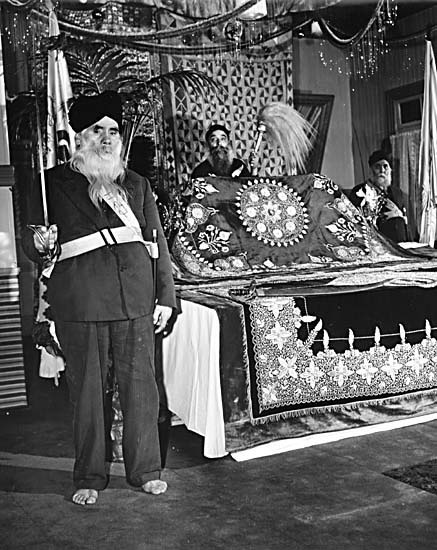 Hari Singh, Lab Singh and Pakhar Singh. The shrine in the Sikh Temple at 1866 West 2nd Avenue [ca. 1946]    Vancouver, BC.     #vancouver #sikhish #temple #singh #religion