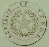 An image of the Seal of Republic of Texas - circular with a star in the center and the words Republic of Texas around the edges