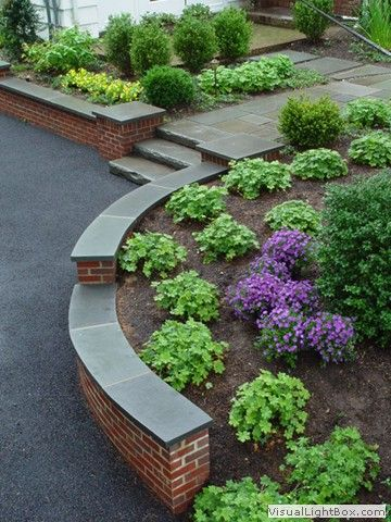 rock fence designs curved brick retaining wall with front yard plantings stone slab steps - Retaining Wall Designs