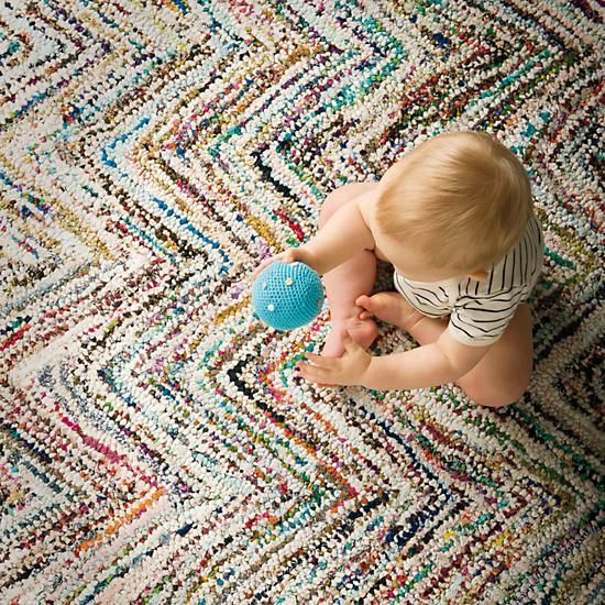 No need to get up and adjust your rug. The irregular chevron color pattern is a result its hand-loomed and recycled fabric construction. Exact coloring may vary slightly.
