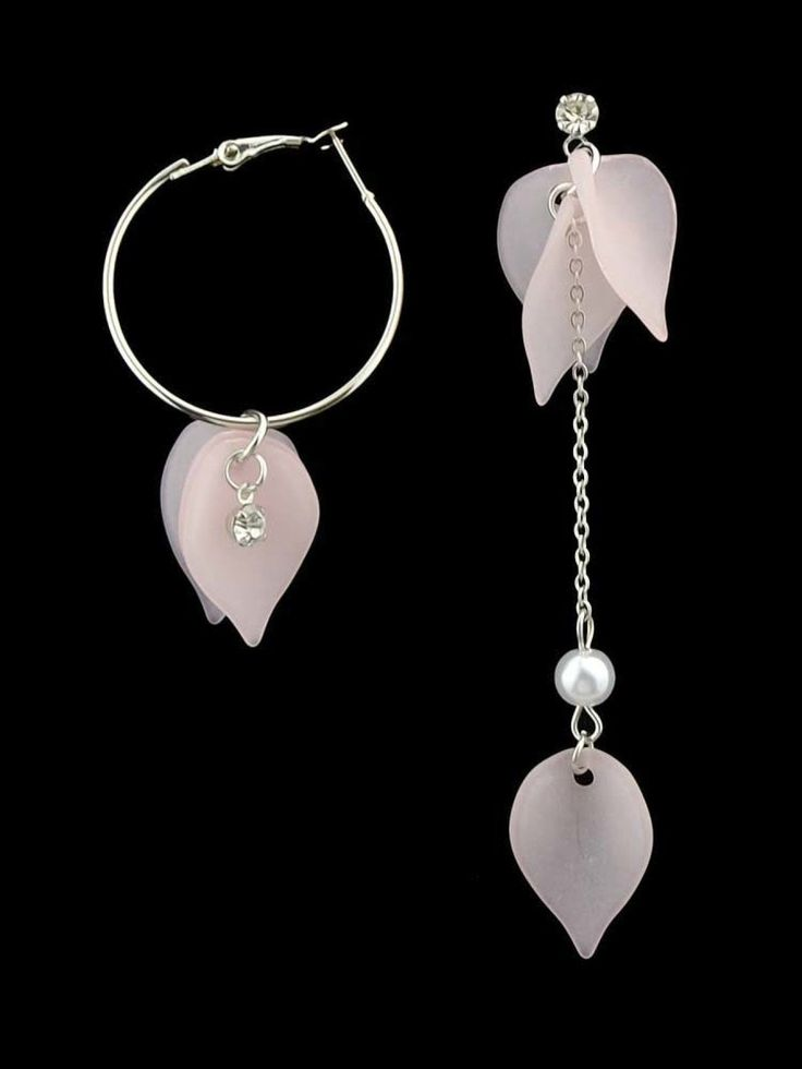 Crystal, Pearls. Silver colored metal. Dangle Perfect choice for Elegant wear. Designed in Pink.