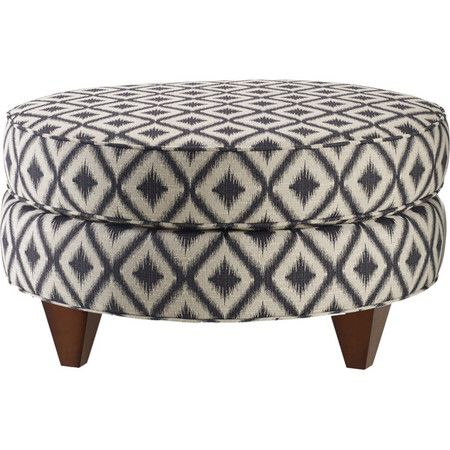 Cotton-upholstered cocktail ottoman with a diamonds motif and square taper legs.   Product: Cocktail ottomanConstruc...