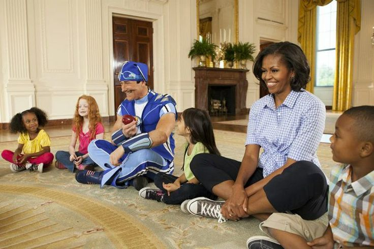 Sportacus of Lazy Town with kids and Michelle Obama at the White House.
