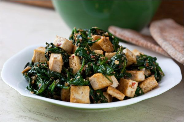 Tofu sesame spinach stir fry     You can serve this simple stir-fry with grains or noodles, or (my preference) use it as a filling for a whole wheat pita pocket.
