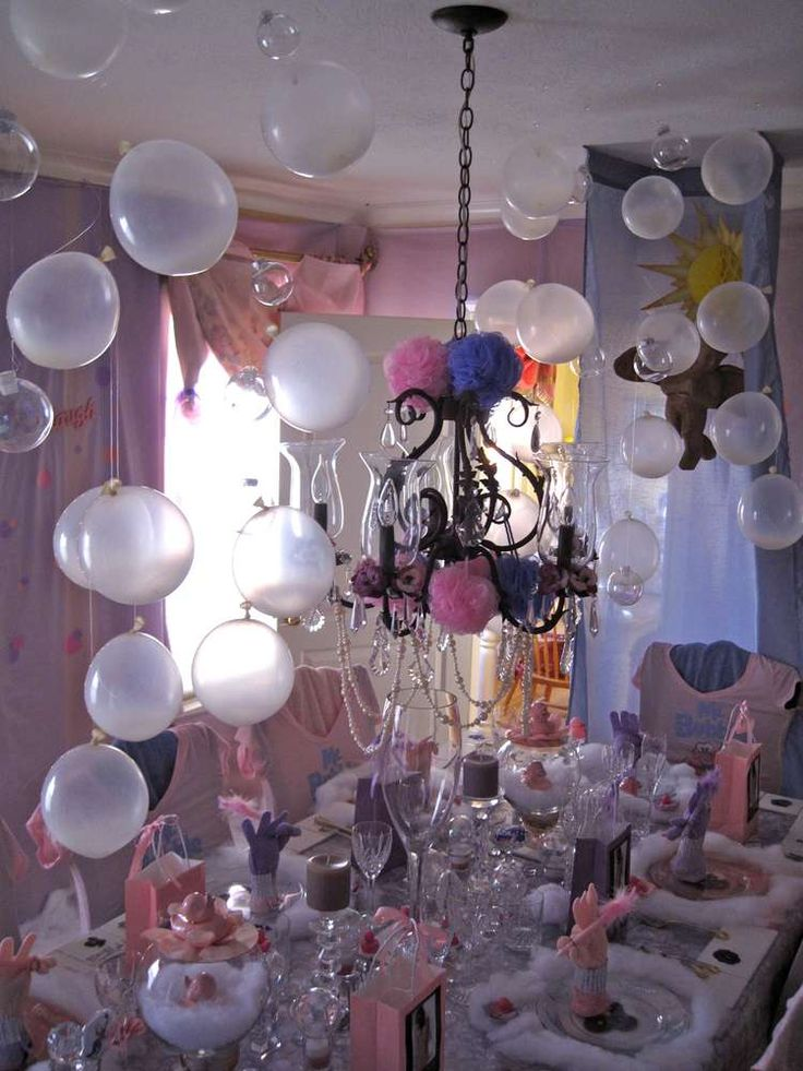 "Balloons and clear glass ornaments as ""bubbles"" for decorations at a spa-themed party"