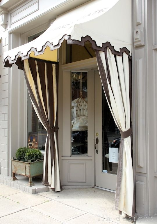 store front - we need a new awning, door color and I like the ideas of the hanging outdoor drapes around the awning.