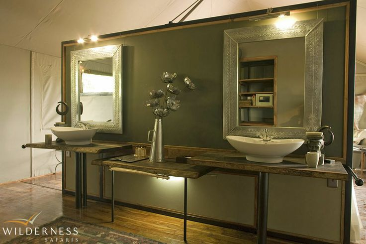 Chitabe's spacious en-suite bathrooms include double vanity basins together with an indoor as well outdoor shower.  #Botswana #Africa #safari