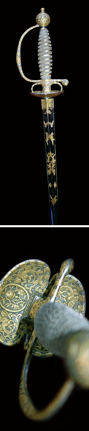 18th Century, Gold Overlaid, Steel Hilted Small Sword Super high quality small sword, gilded silver wire wrapped grip; the blade a colichemarde pattern (3 sided), is in mint condition, fire gilded blue & gold decorated.