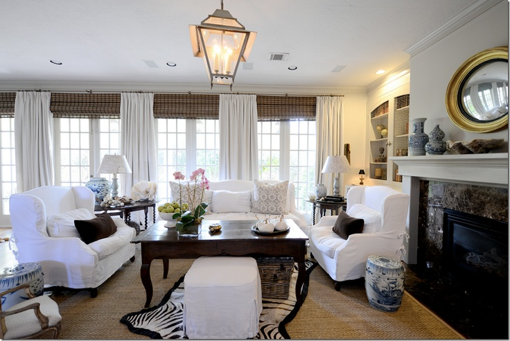 Love everything about this room, including lantern, sisal rug, slipcovers, bamboo shades....