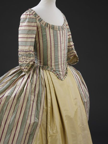 Robe à la polonaise, English, 1775-1780.  Robe and Polonaise of lustring striped in pale green, cream and two shades of purple, with boning and lined with linen.
