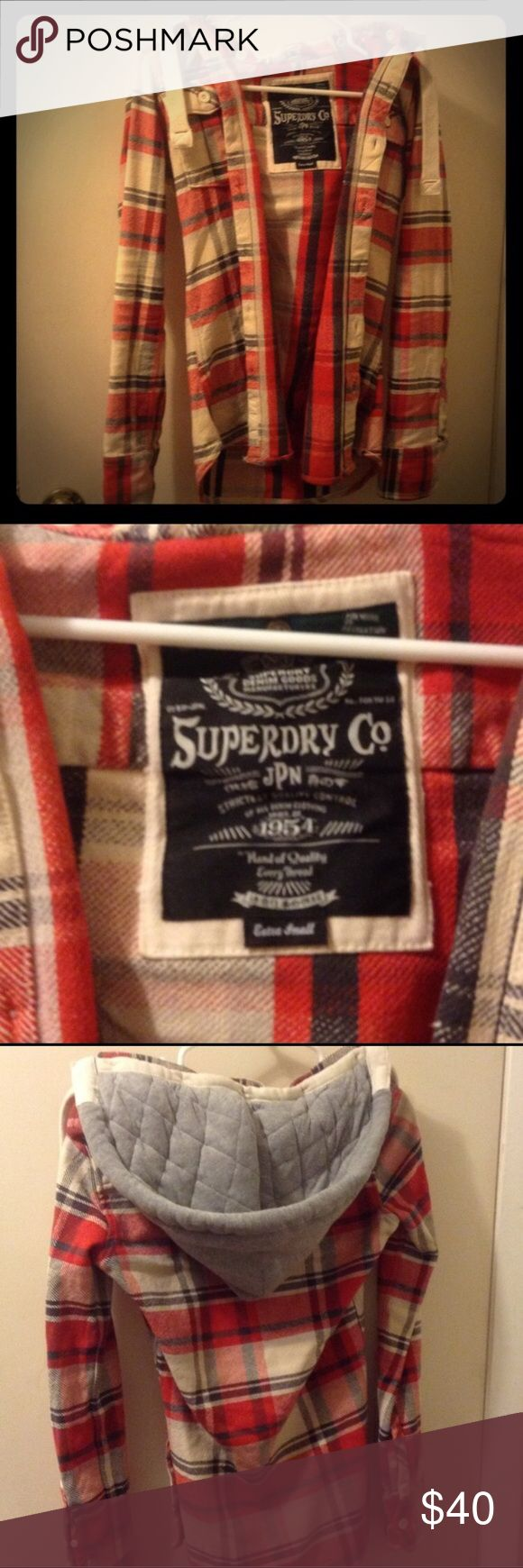 Superdry plaid button up with removable hood Superdry plaid button up with removable hood. Can be used alone or over a tank/ light layer jacket. Thick, quality material. Superdry size XS. Fits a size 2-4. Superdry Tops