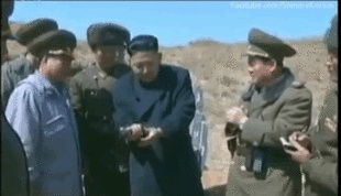 kim jung holding a gun and firing at someone or something? kim jong un launches rocket while smoking Camels get the inside news on North Korea http://miami-water.com/blog/kim-jung-un-north-korea-war-news-today-rocket-attack-nuclear-army-ready/