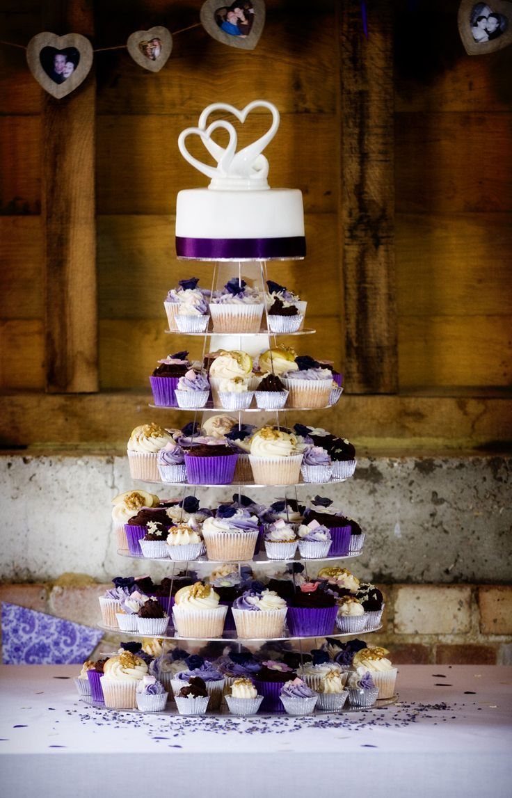 Cupcake tower with array of different purples. Cupcakes, frostings and flavours were all designed to compliment each other and fruit cake topper with ceramic hearts www.beautyandthebakery.co.uk