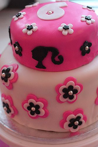 Barbie Cake...cute w/out being over the top Barbie, although the silouette on this cake looks a little off.