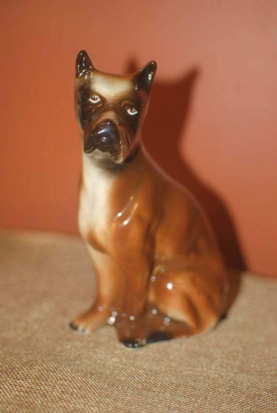 Check out this item in my Etsy shop https://www.etsy.com/listing/269928483/vintage-boxer-bulldog-figurine-made-in