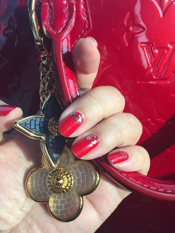 Louis Vuitton Alma Bag with Dior red nails.