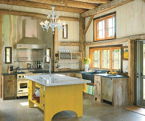 Where can I find a repurposed log cabin to live in?! Also: that yellow island and ice blue chandelier.