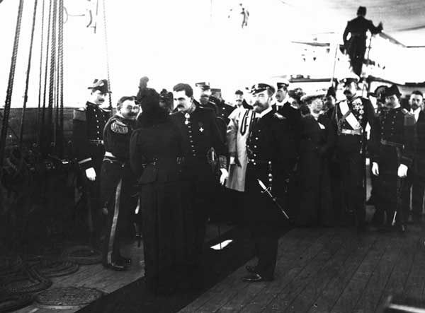 """Tsar Nicholas ll of Russia and Empress Alexandra Feodorovna of Russia greeting a group of marine officers.    """"AL"""""""