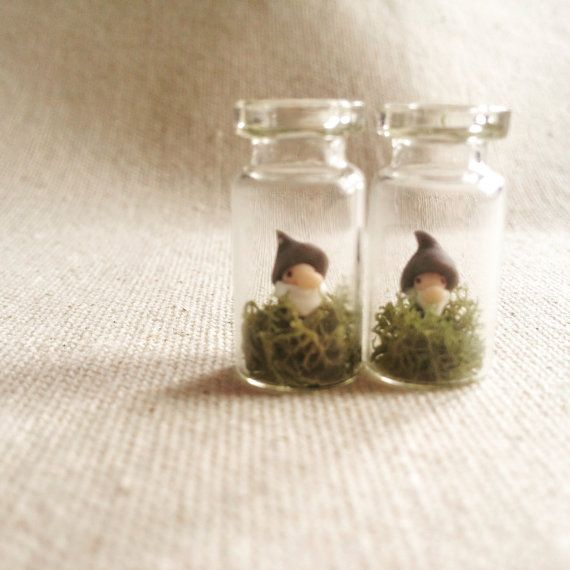 This listing is for one jar with one gnome hanging around in some reindeer lichen. A hook is inserted into the cork top and voila! Instant pendant. When two gnomes are similar enough in stature and demeanor, theyre made into earrings, so ask about a custom order if youre keen to nab a set of those instead