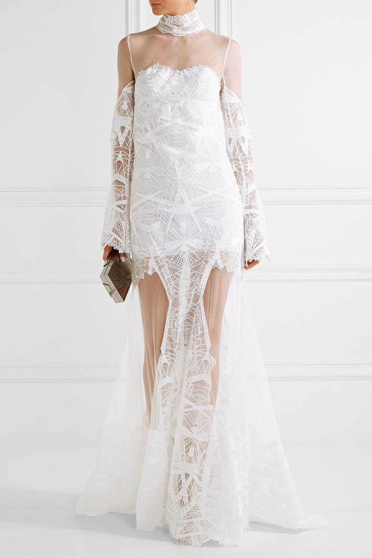Jonathan Simkhai's white gown was the final look to come down the designer's Fall '16 runway. Crafted from intricately embroidered tulle, this floor-sweeping style has a sheer yoke that's delicately suspended from the chic high collar. Wear yours with pared-back accessories.   Shown here with: Lee Savage Clutch, Giuseppe Zanotti Sandals, Charlotte Chesnais Earrings, Maison Margiela Ring.