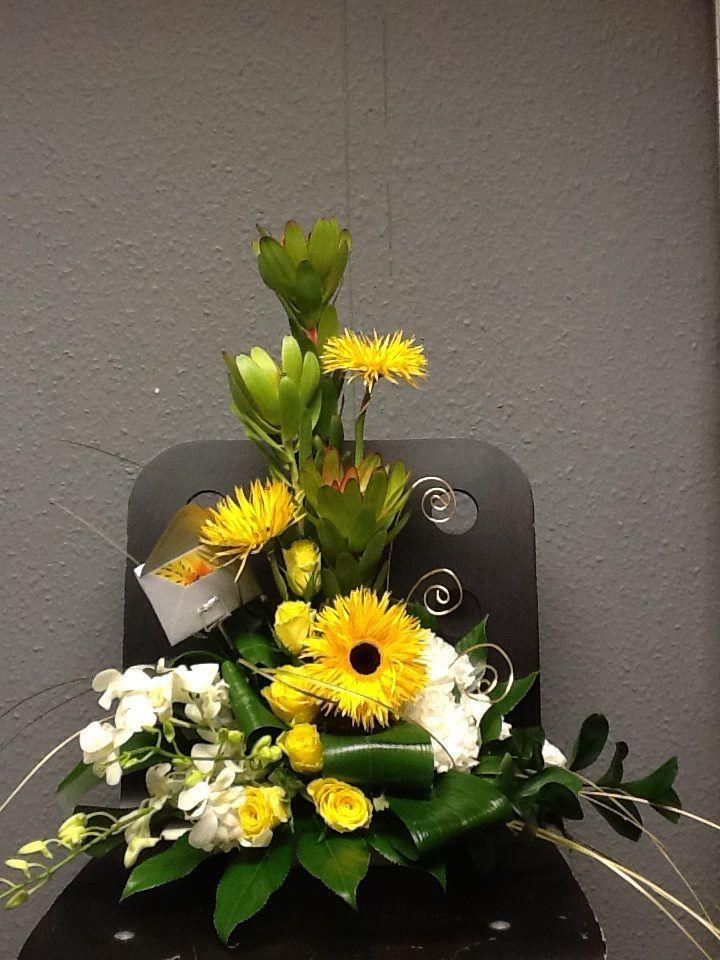 Golden wedding arrangement. The Rose House at McEwens #flowers