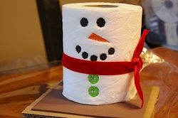 extra roll of toilet paper - cute idea for holiday decoration in the bathroom :)