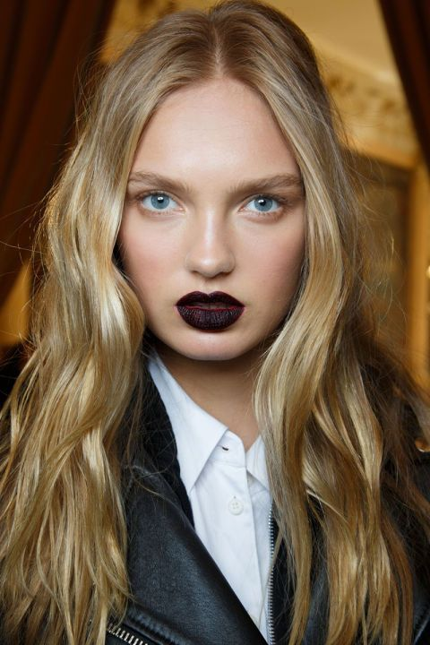 In a season rife with '90s references, it only follows that goth lips would emerge as a trend. But something about pairing almost-black lipstick with soft, beachy waves (at Emanuel Ungaro, left), casual buns and stud-free clothing made them a whole lot less intimidating to try.
