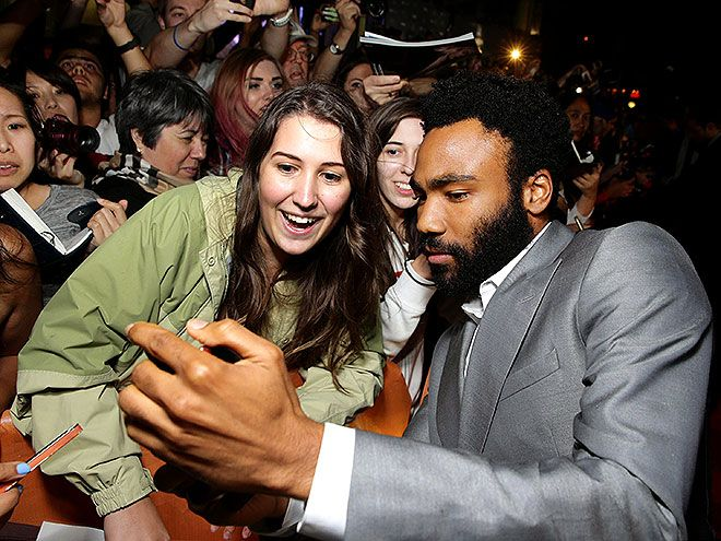 DONALD GLOVER | Glover takes a selfie with a fan at The Martian premiere on Friday. #TIFF #TIFF2015