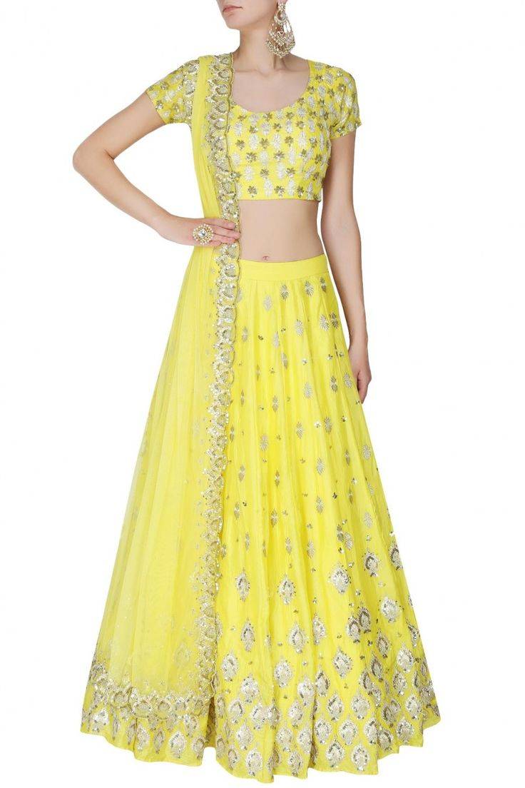 This set features a yellow lehenga in silk base with gold gota and sequins motifs all over the front and back. It has a can-can underlayer. It comes along with a matching yellow blouse with gold and s