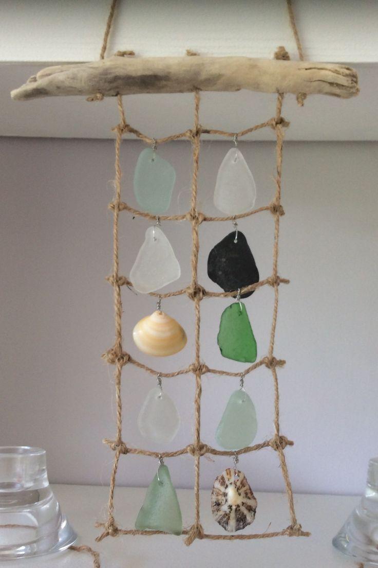 Mermaid curtains, sea glass, driftwood and shells