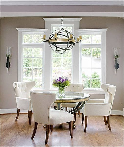 White and taupe dining room with great windows. Dining