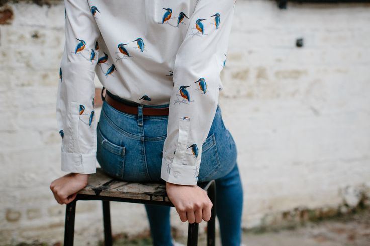 White shirt with humming bird print, tucked into high waist jeans by Gibson & Birkbeck
