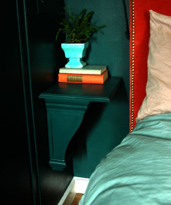 ...zero space for nightstands? Buy a pair of corbels. (Home Depot) They fit the narrow space perfectly. Stop by local craft store and check out the wood plaque section (Michaels) - 2 drywall screw-ins later...a nightstand! They add a little something to the lines of the room, but they also disappear since they're the same color as the wall.