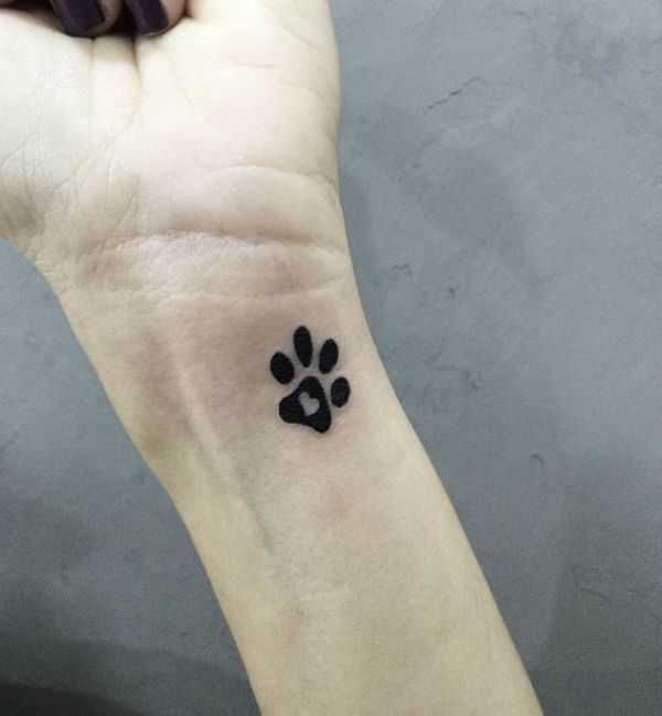 38 Dog tattoos to celebrate your four-legged best friend: Heart path paw prints…