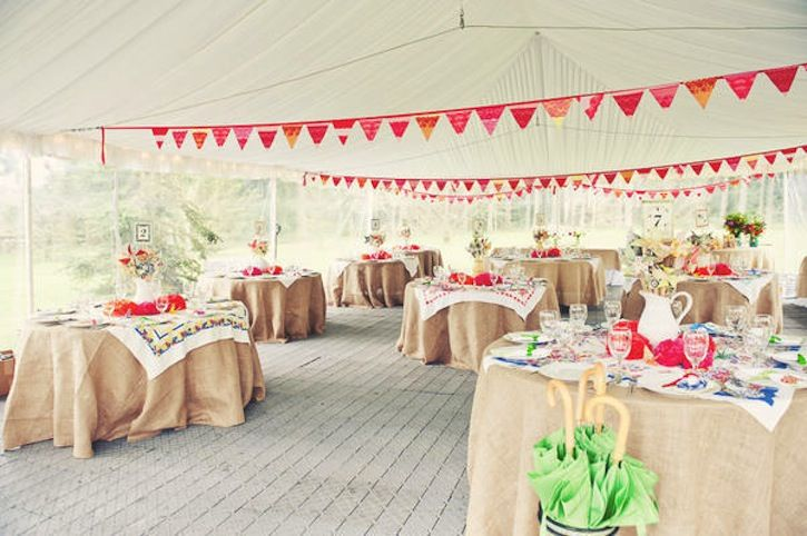 Colorful bunting and burlap tablecloths via Once Wed.
